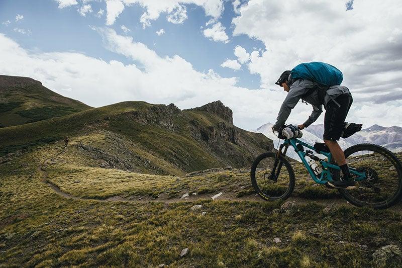 A bikepacker rides on the Colorado Trail.