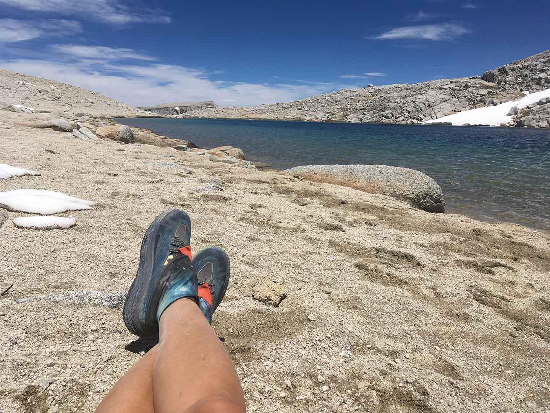 Taking a break at a bright blue alpine lake.