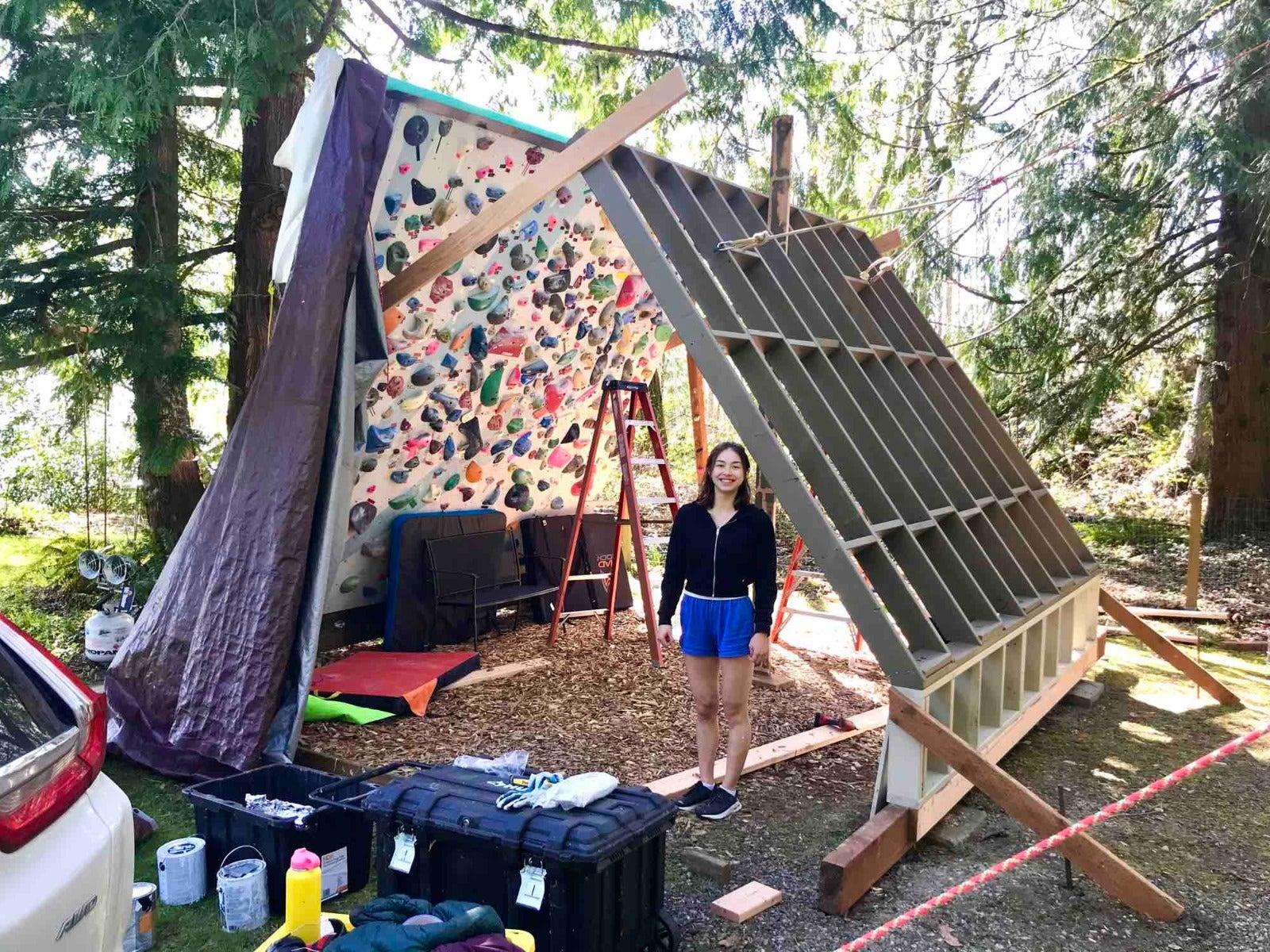 Quinn Mason at work on the bouldering walls.