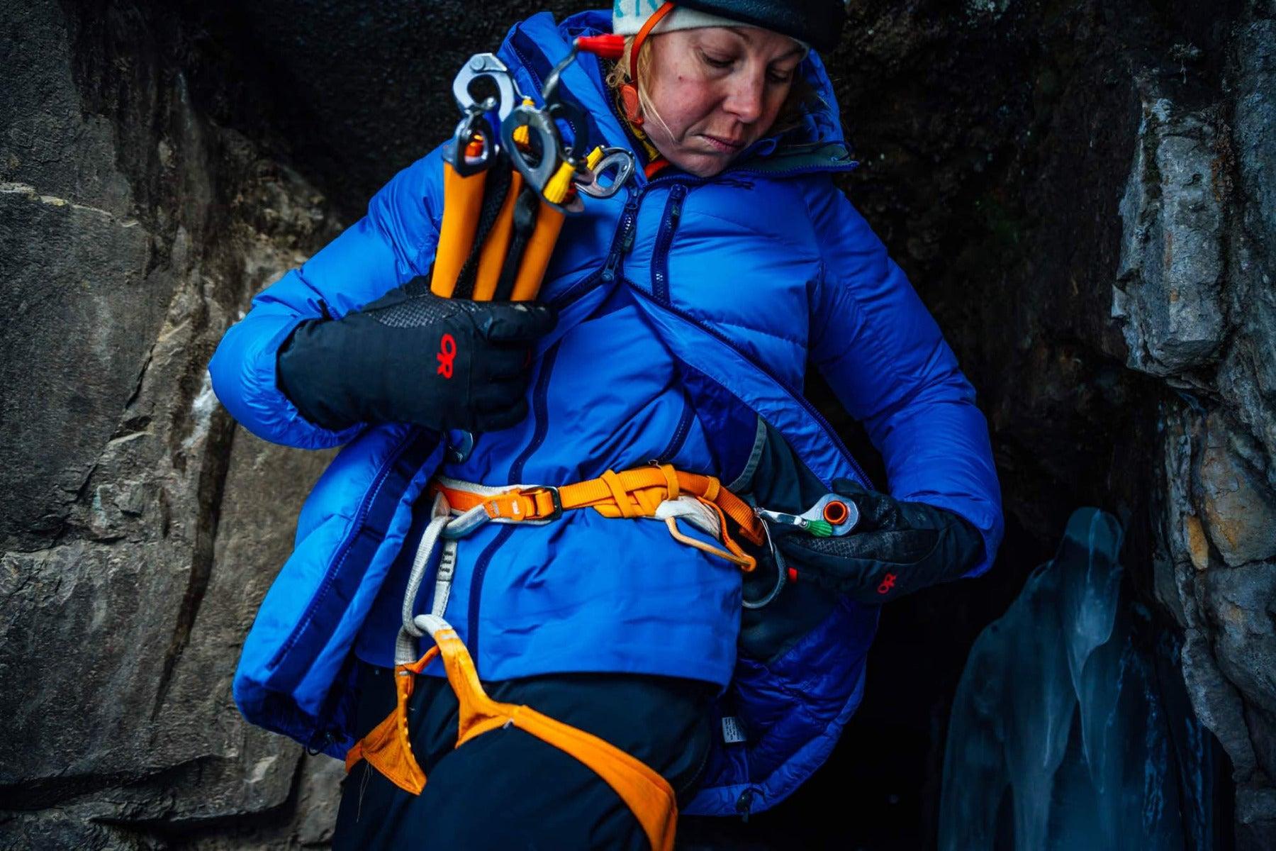 An ice climber wears the Bitterblaze Gloves.