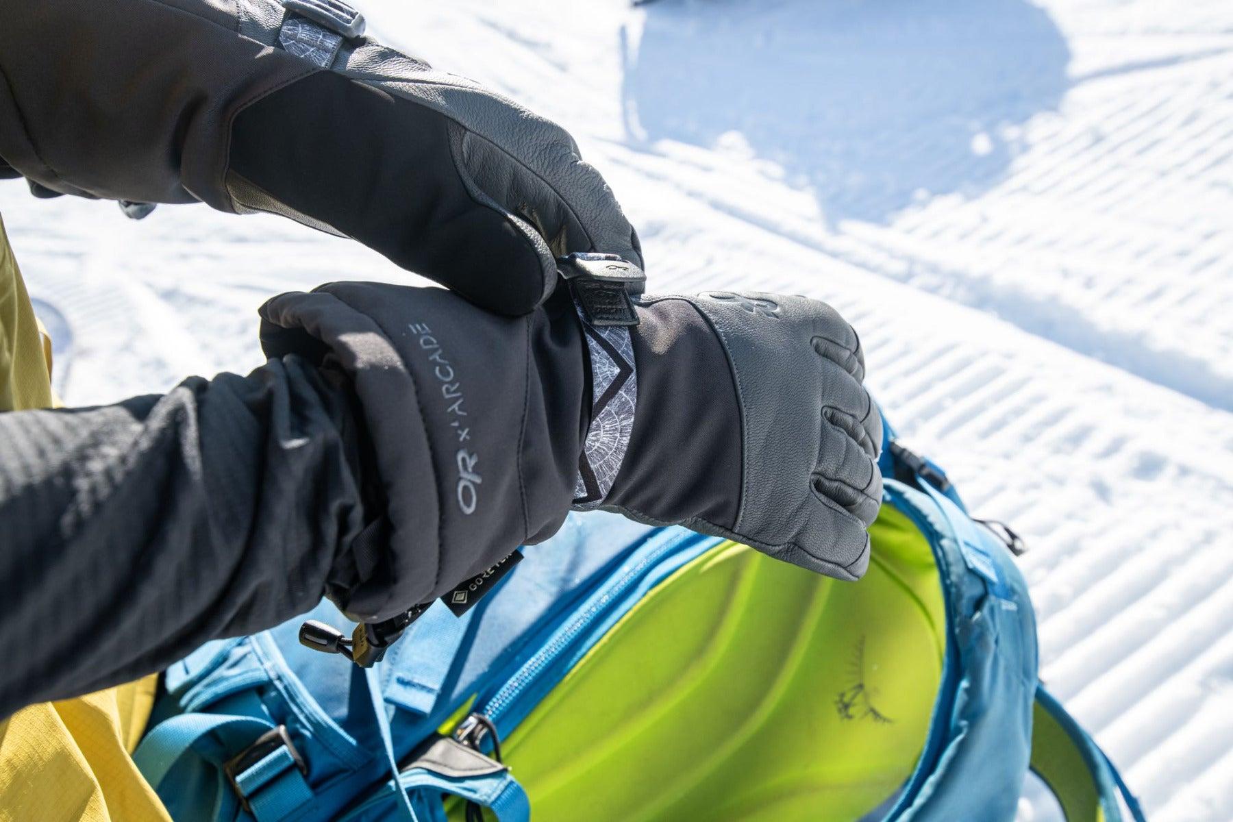 A skier wears the Carbide Sensor Gloves.
