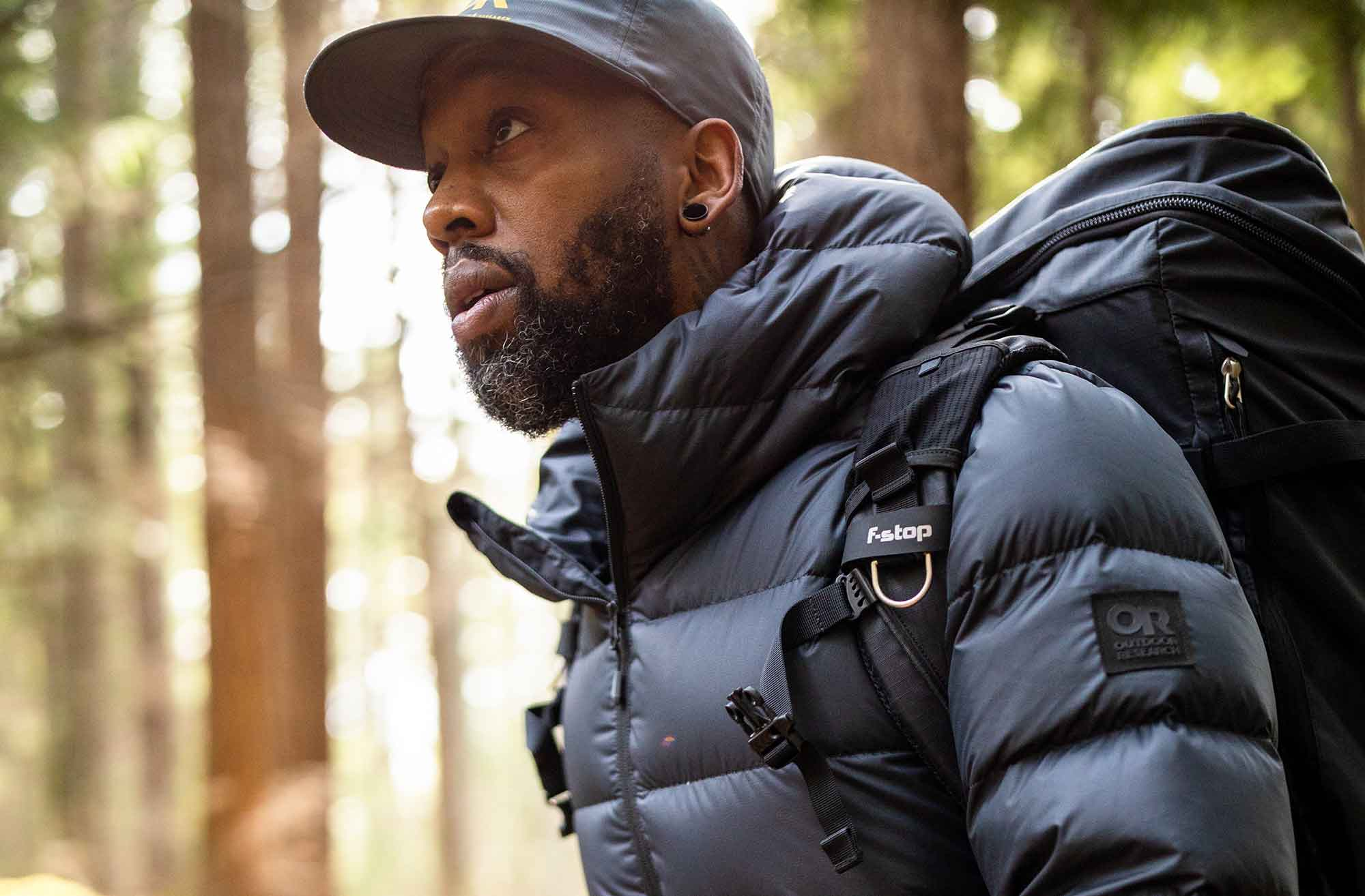 A climber wears the Coldfront Down Hoody.