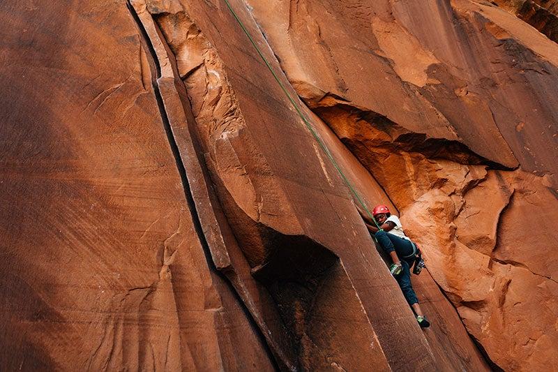 Female climbs a route in Utah