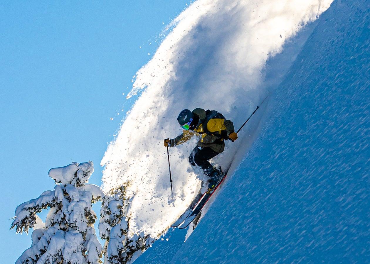 Outdoor Research Ski Ambassador Micah Evangelista descending a steep ski line